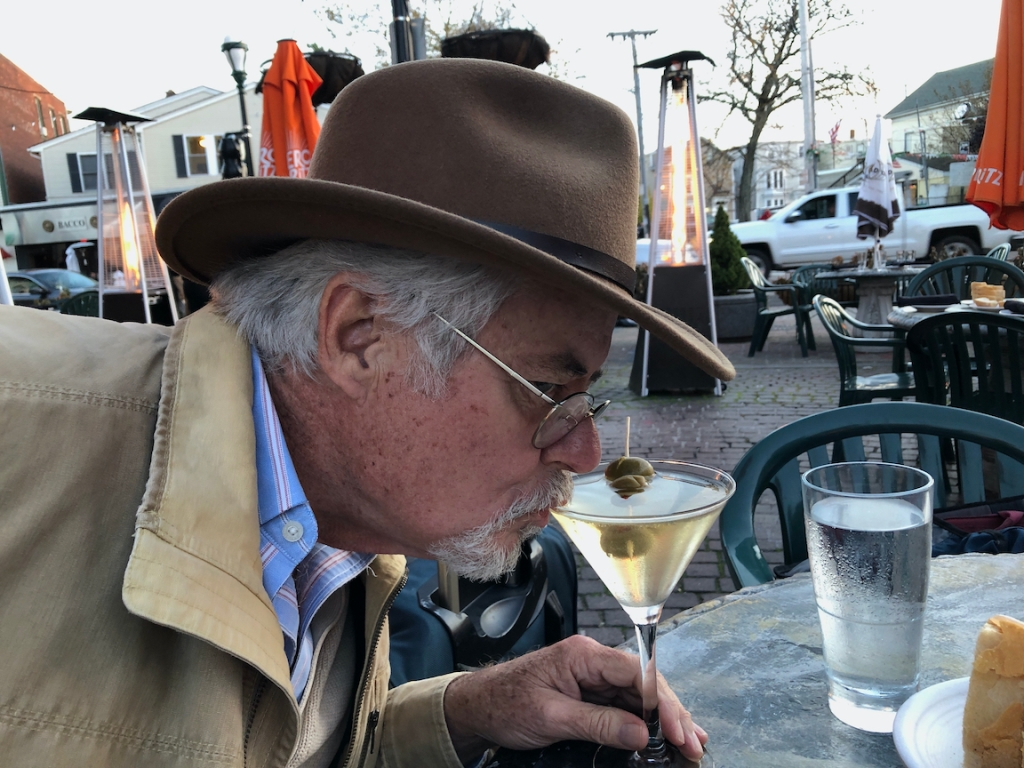 Man drinking martini